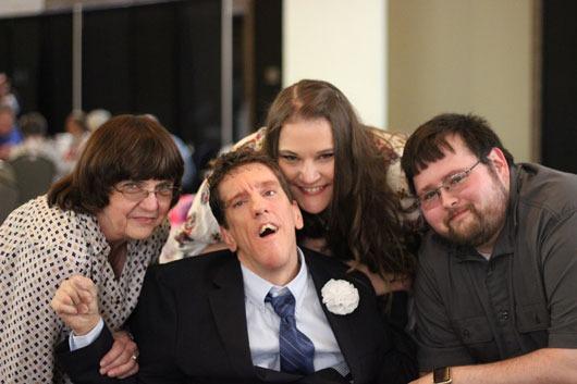 Happy family group photo at the award ceremony