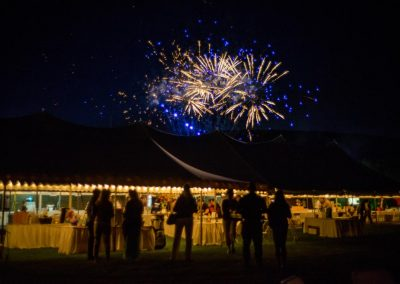 Savor the Summer fireworks over a tent